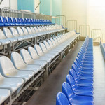 number of blue and white seats in the grandstand of a sports hall