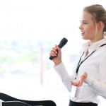 Businesswoman giving a presentation to audience